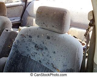 Automobile car seat shot up bullet gun fire holes