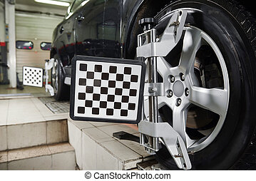Automobile car wheels with computerized alignment machine clamp