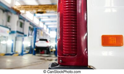 Automobile diagnostic service - mechanics working, manual...