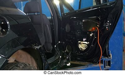 Automobile diagnostic service - mechanics working - car for...