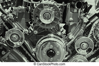 Close up shot of engine showing belts and chains
