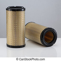 automobile filter on a white background - two automotive...