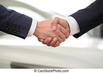Automobile industry - Good deal. Close-up shoot of the hands...