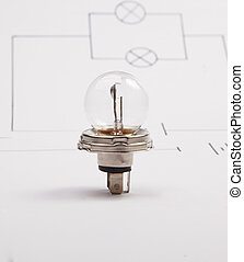 Automobile lamp on a background of the electric scheme