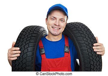 automobile mechanic with car tire - serviceman repairman...