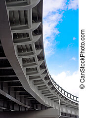 automobile overpass on background of blue sky with clouds....