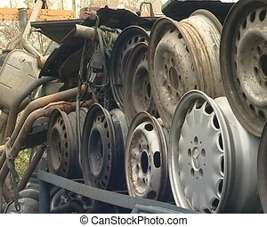 Automobile parts in dump. Silencers