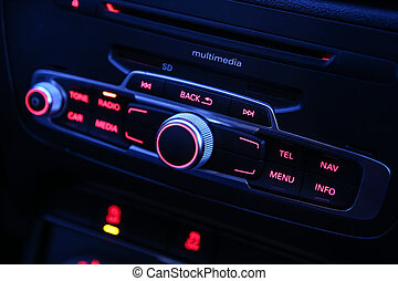 automobile radio receiver which is switched on shining red...