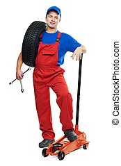 automobile repairman with tire and lifting jack - serviceman...