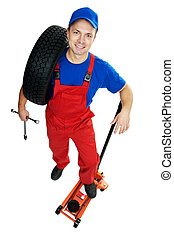 automobile repairman with tire and lifting jack