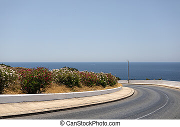 Automobile road by the sea on a sunny day in Malta