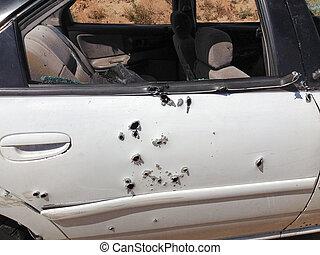 Automobile shot up bullet gun fire holes