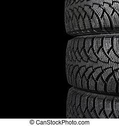 Automobile tire on black background