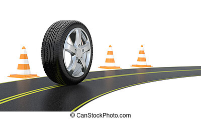 automobile tire, road cone,  and long road