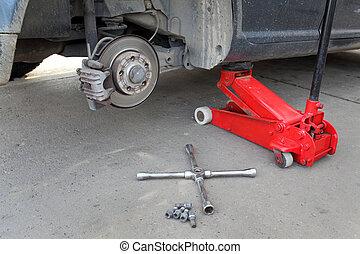 Automotive, brakes - Car at hydraulic jack, disc brakes,...