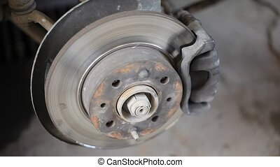 Closeup video of car disc brakes servicing