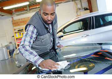 automotive glass mechanic working