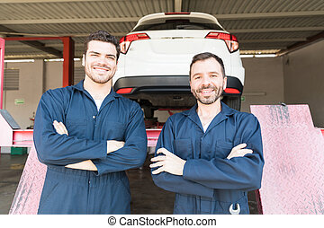 Automotive Workers Showing Contentment In Garage