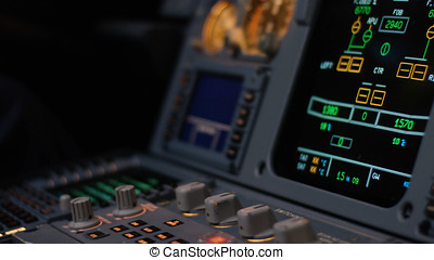 Autopilot control element of an airliner. Panel of switches on an aircraft flight deck. Thrust levers of a twin engined airliner. Pilot controls the aircraft. Onboard computer, cockpit