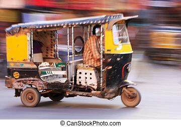 Autorickshaw in the street of Sadar Market, blurred motion,...