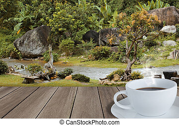 Autum landscape with wooden floor and hot coffee cup