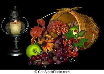 Harvest fruits spilling out of bushel basket.