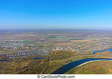 Autumn aerial landscape of Tura river in Russia