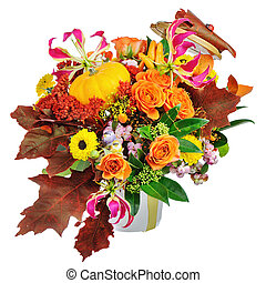 Autumn arrangement of flowers, vegetables and fruits isolated on