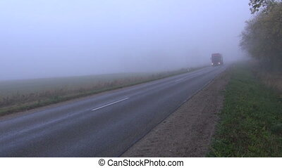 road with truck and morning fog