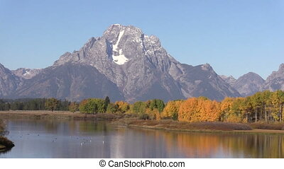 Autumn at Oxbow Bend - an autumn reflection of the tetons...
