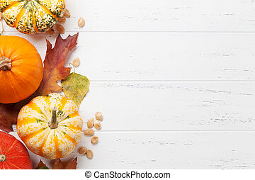 Autumn backdrop with pumpkins and colorful leaves