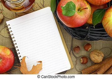Autumn background basket with apples and notebook