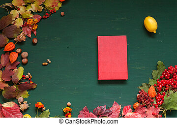 autumn background book yellow and Red leaves of berries fruits nuts