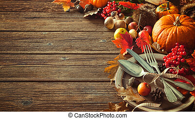 Autumn background from fallen leaves and fruits with vintage place setting