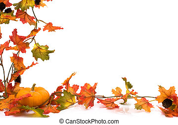 autumn background - Fall leaves with a pumpkin at the...