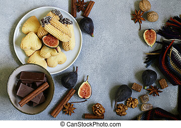 Autumn background with chocolate, spices and cookies