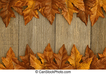 Autumn background with fall leaves on weathered wood