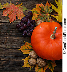 Autumn background with leaves and pumpkin