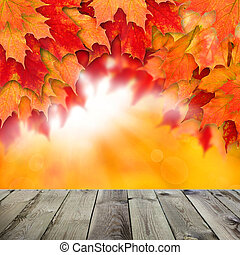 Autumn background with leaves. Colorful fall leaves and abstract gold bokeh light with empty dark wooden board background