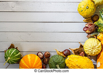 Autumn background with pumpkin and leaves