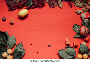 autumn background with red and yellow fallen leaves and fruits
