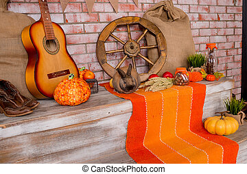Autumn background with Rye, wheat, with yellow maple leaves, pumpkins, red apples. Frame of fall harvest on aged wood with copy space. Mock-up for seasonal offers and holiday post card. Autumnal decoration.