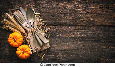 Autumn background with vintage place setting on old wooden table