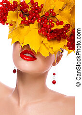 Autumn beauty woman. Beautiful makeup. Yellow leaves, berries