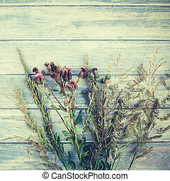 Autumn bouquet of dry flowers and grass
