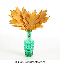Autumn bouquet of oak leaves in a vase with colored glass on a white background