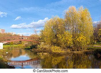 Autumn - bridge in autumn park