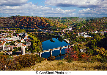 Autumn cloudy view from above to Cahors railway bridge, France