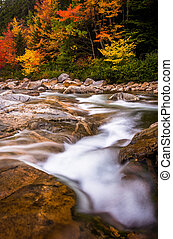 Autumn color and cascades on the Swift River, along the Kancamagus Highway in White Mountain National Forest, New Hampshire.