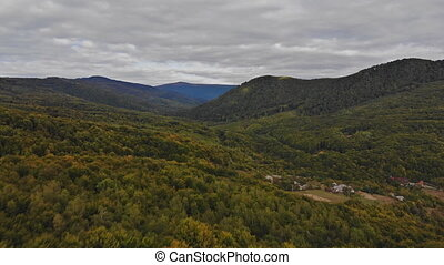 Autumn color forrest view over colorful autumn trees, mountains, on a sunny fall day